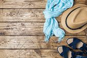 Summer Womens Clothes. Flat Lay Fashion Photo. Scarf And Sun Hat, Blue Sandals On Wooden Background. poster