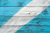 The Texture Of Old Wooden Shield With Shabby Surface Painted In Cyan And White Colors poster