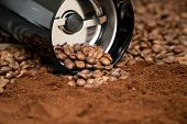 Black Coffee Grinder With Coffee Beans Isolated On The Wooden Tables. Coffee Was Fell Out Of The Cof poster