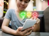 Customer Service Experience And Business Satisfaction Survey. Woman Choose Face Smile On Smart Phone poster