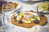 Cheese Plate With Cheeses Dorblu, Parmesan, Brie, Camembert And Roquefort In Serving On The Table Fr poster