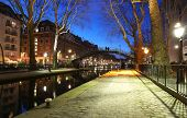 The Canal Saint-martin At Night .it Is Long Canal In Paris, Connecting The Canal De Lourcq To The Ri poster