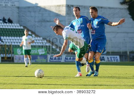 KAPOSVAR, HUNGARY - OCTOBER 20: Unidentified players in action at a Hungarian National Championship soccer game - Kaposvar (white) vs Siofok (blue) on October 20, 2012 in Kaposvar, Hungary.