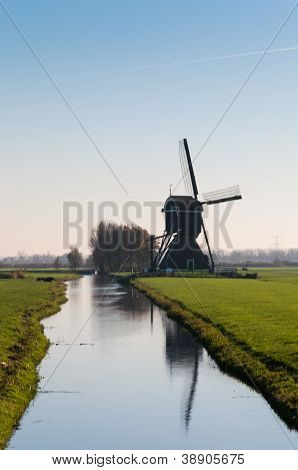 Typical Dutch Windmill In Backlight