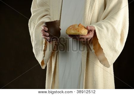 Jesus holding bread and a cup of wine as a metaphor