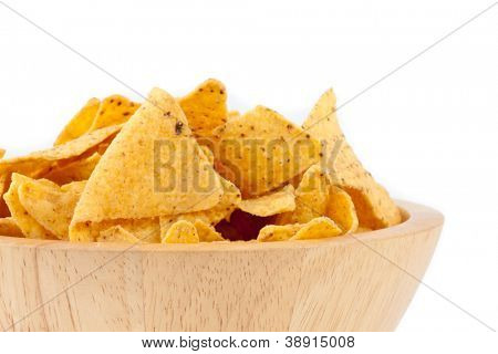 Bowl full of crisps against white background