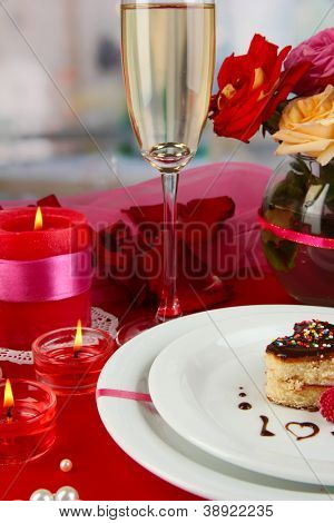 A wedding ring in glass as a gift on celebratory table in honor of Valentine's Day on room background