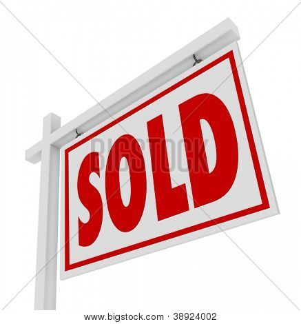 A white real estate for sale sign with the word Sold representing a successfully closed home, house or property transaction
