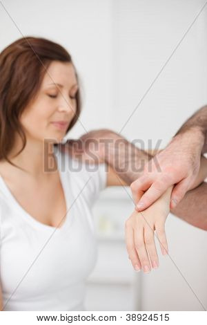 Peaceful patient being examined by a doctor in a room