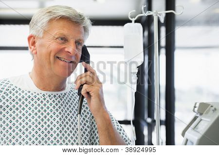 Patient on payphone in hospital corridor