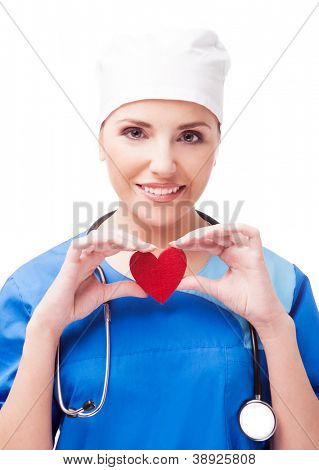 cardiologist with a red heart in her hands, isolated on white background