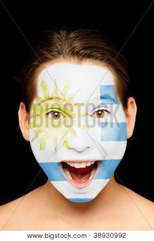 portrait of girl with uruguayan  flag painted on her face