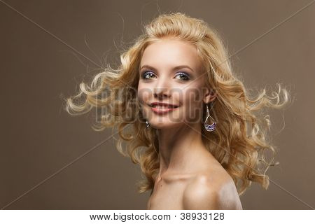 Face of a sexy young caucasian woman with curly blond hair