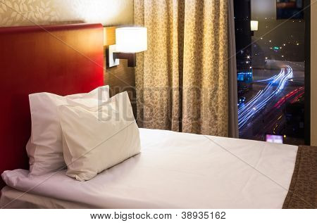 hotel room interior with window at night