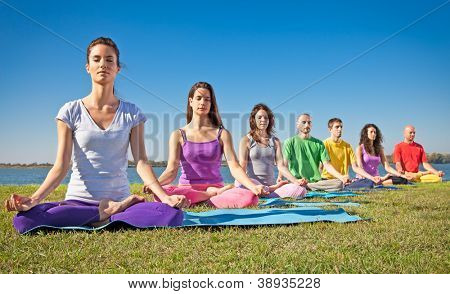 Group of young people have meditation on yoga class. Yoga concept.