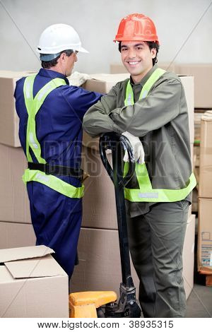 Portrait of foreman with colleague working at warehouse