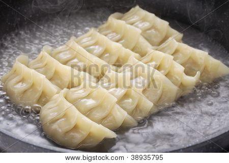 cooking gyoza dumplings, potstickers, japanese food