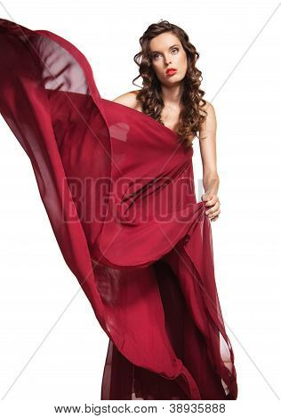 woman in red dress with curly hair