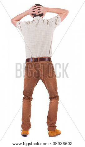 Back view of angry young man in jeans and shirt. Rear view. isolated over white. backside view of person.  Rear view people collection. Isolated over white background.
