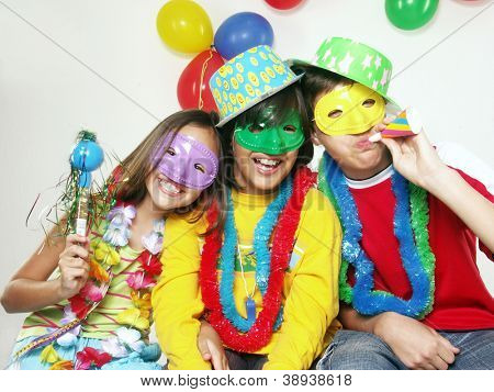 Three funny carnival kids portrait