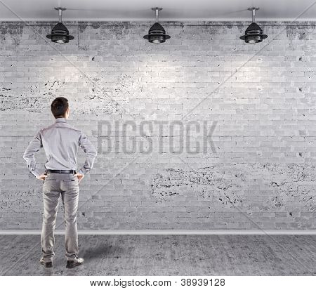 young attractive business man in front of a vintage old blank wall