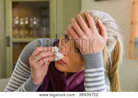 woman on sick leave with a handkerchief and drugs. cold, cold and flu season
