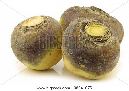 three fresh turnips(brassica rapa rapa) on a white background