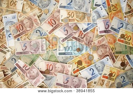 Reais (Real), Brazilian money background with coins and bills.