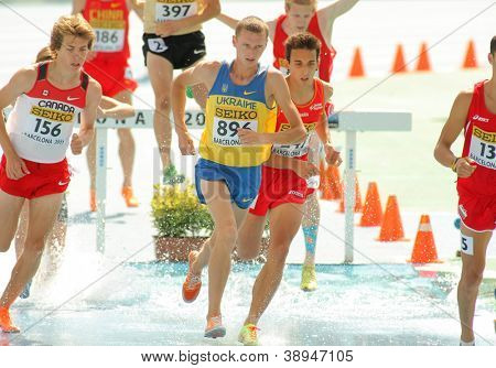 BARCELONA - JULY, 13: Ivan Savka of Ukraine during 3000m steeplechase event the 20th World Junior Athletics Championships at the Olympic Stadium on July 13, 2012 in Barcelona, Spain