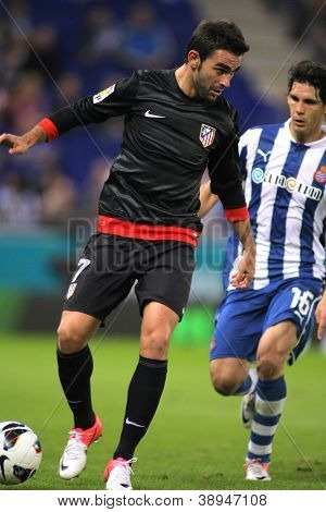 BARCELONA - SEPT, 30:Adrian Lopez of Atletico Madrid during a Spanish League match between Espanyol and Atletico Madrid at the Estadi Cornella on September 30, 2012 in Barcelona, Spain