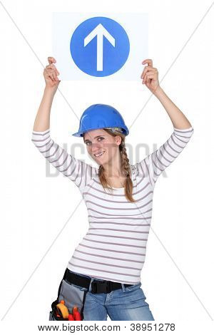 Female construction worker with sign