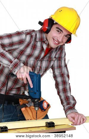 young carpenter all smiles using drill