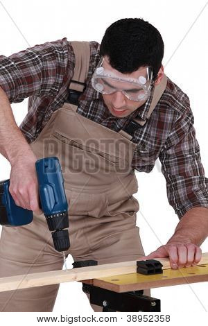 Handyman using a screwdriver