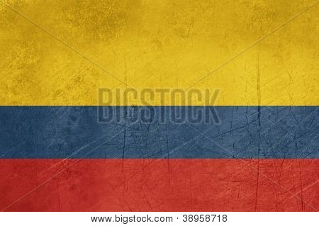 Grunge sovereign state flag of country of Colombia in official colors.