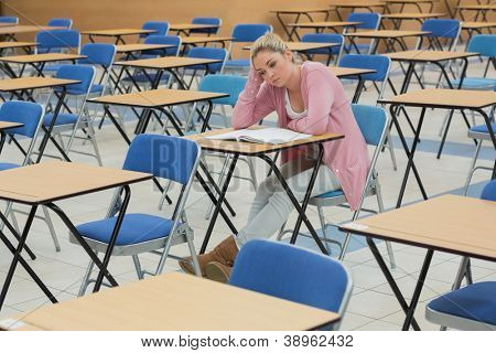Student sitting at desk while thinking