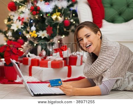 Happy Woman With Laptop Near Christmas Tree Making Online Purcha