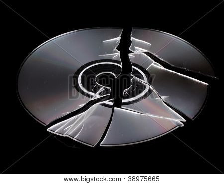 Broken disk with information isolated on black