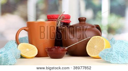 Helpful tea with jam for immunity on wooden table on window background