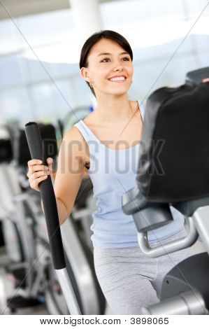 Girl On The Xtrainer At The Gym