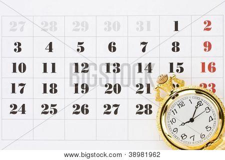 pocket watch on calendar background