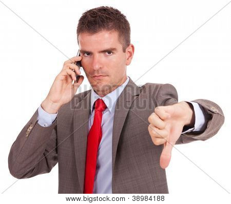 Business man with bad news on his cell phone disapproving . negative answer