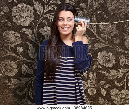 Female Holding A Metal Tin As A Telephone, Indoor