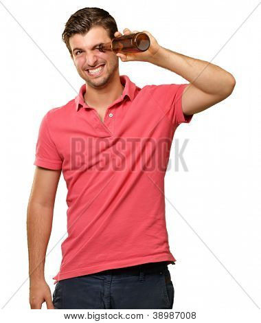 man looking inside an empty bottle isolated on white background