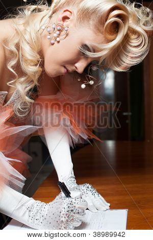 Elegant bride signing wedding prenuptial agreement