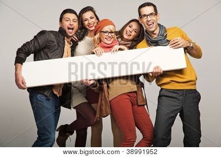 Smiling people  with empty board