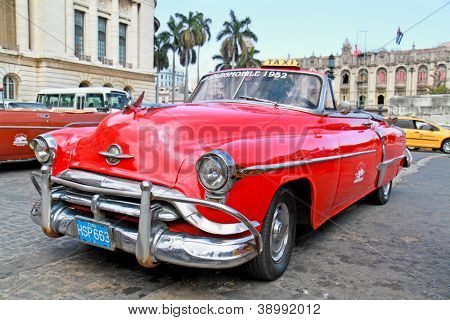 HAVANA-FEB 3:Classic Oldsmobile waiting for tourists on February 3; 2010 in Havana.Thousands of these vintage cars are in use in Cuba and have become a touristic attraction.