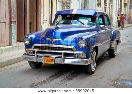 HAVANA-FEB 4:Classic Oldsmobile waiting for tourists on February 4,2010 in Havana.Thousands of these vintage cars are in use in Cuba and have become a touristic attraction.