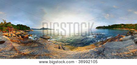 Panorama of a rocky coast of Andaman sea near Laem Sing beach at sunset. Phuket, Thailand