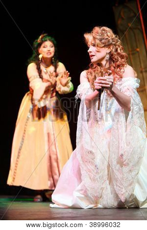 """MOSCOW - FEBRUARY 3: Actress Anastasia Makeeva with dagger in musical """"Francois Villon. Three days in Paris"""" at Palace on Yauza on February 3, 2012 in Moscow, Russia."""