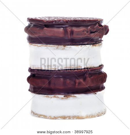 some argentinean-uruguayan alfajores with different flavors on a white background